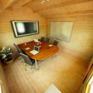 Picture Inside Log Cabin of TV and Large Table Chairs