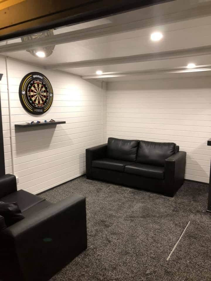 Converted Log Cabin with Dart Boards