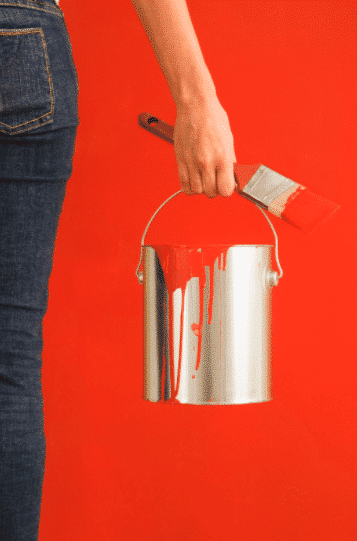 Person Holding Red Paint, Paint Brush, Painted Red Wall